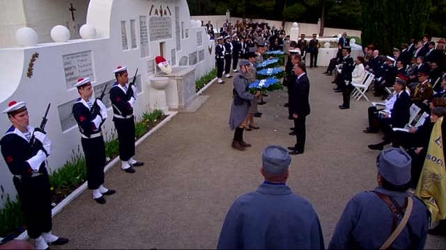 prince charles of wales and the leaders of foreign countries visit the french national war cemetery and memorial and place wreath on memorial during... - 100th anniversary stock videos & royalty-free footage