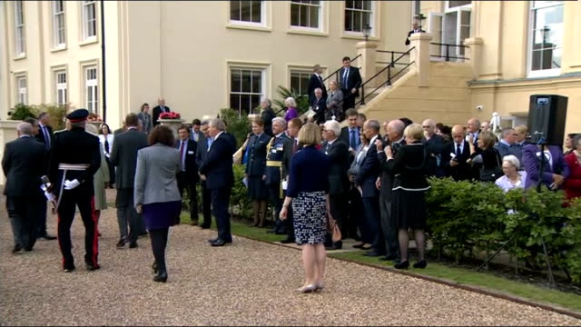 vidéos et rushes de prince charles opens battle of britain museum; **music heard sot** charles, camilla and burridge along past people then up steps and chatting to... - museum