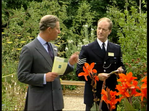 Prince Charles opens Millennium Seed Bank West Sussex EXT GVs Prince Charles the Prince of Wales towards with others thru flower garden during...