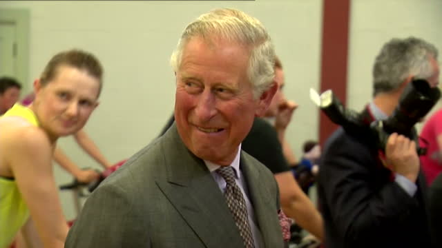 prince charles opens sports centre in ayr. shows interior shots prince charles getting down from exercise bike & speaking to women taking part in the... - ayr stock videos & royalty-free footage