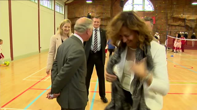 prince charles opens sports centre in ayr. shows interior shots prince charles talking with women taking part in spin class & woman at the back... - ayr stock videos & royalty-free footage
