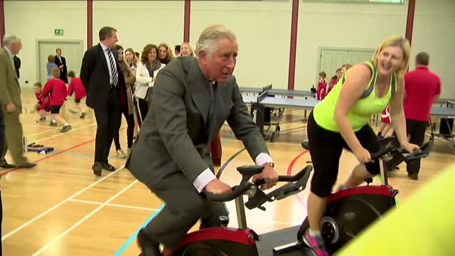 prince charles opens sports centre in ayr. shows interior shots prince charles taking part in spinning class, cycling on excercise bike. on april 29,... - ayr stock videos & royalty-free footage