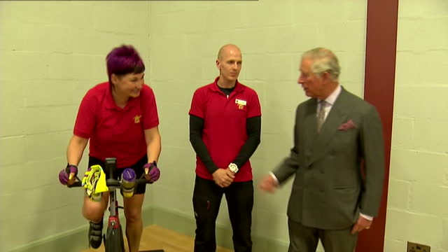 prince charles opens sports centre in ayr. shows interior shots prince charles talking to instructor heading the spin class & talks with one of the... - ayr stock videos & royalty-free footage