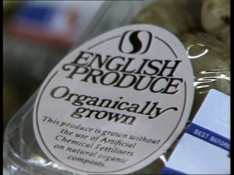 organic farming itn sign 'english produce organically grown' pull out packs of potatoes with the label on in safeways - tag 7 stock videos & royalty-free footage