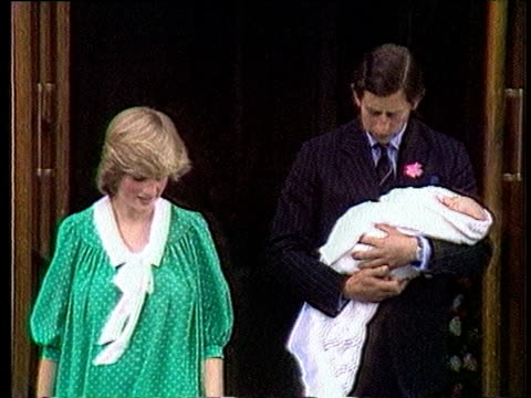 Prince Charles passes his newborn son Prince William to Princess Diana whilst posing for press as they leave St Mary's hospital London 22 Jun 82