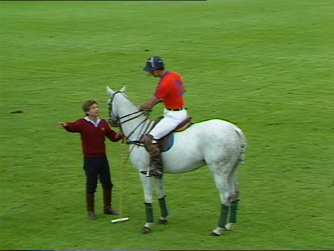 prince charles plays polo at windsor; england: windsor: guards polo club: ext further shots of prince charles, prince of wales, playing in silver... - playing stock videos & royalty-free footage