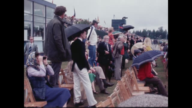 prince charles plays polo at windsor england windsor guards polo club smiths gv games ms charles rl with umbrella and boots through crowd gv crowd... - windsor england stock videos and b-roll footage