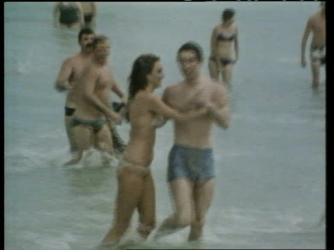 Prince Charles popularity LIB Bondi Beach EXT Prince Charles in sea as accosted by young woman