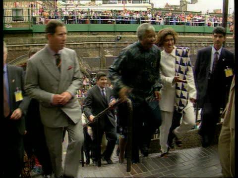prince charles popularity; lib england: london: brixton: ext prince charles, prince of wales towards with nelson mandela during mandela's visit:... - adulation stock videos & royalty-free footage