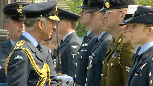 prince charles presents medals at raf odiham more of charles presenting medals / charles away from ceremony then saluting / charles into car and away... - saluting stock videos & royalty-free footage