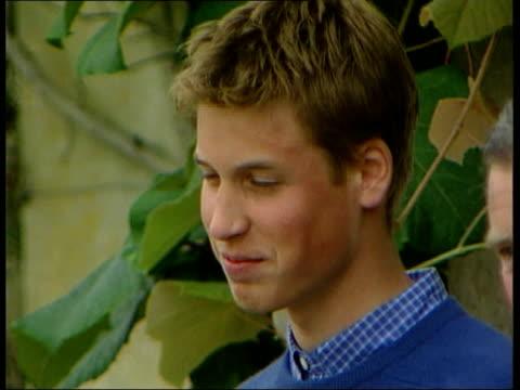 prince charles' press secretary resigns; lib gloucestershire: highgrove: cms prince william william posing with father prince charles and brother... - 皇族・王族点の映像素材/bロール