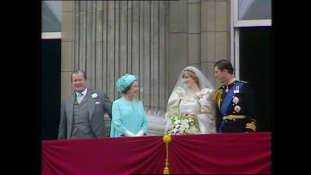 prince charles, princess diana, queen elizabeth ii and earl spencer stand and wave from the buckingham palace balcony on the day of the wedding of... - waving stock videos & royalty-free footage