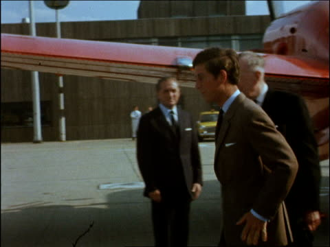 Prince Charles returns from Norway ENGLAND London Airport EXT Aircraft taxiing on tarmac / Prince Charles down steps from plane handshakes / Prince...