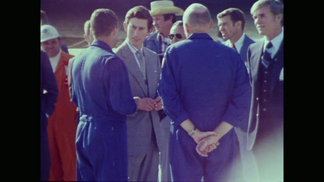 vídeos de stock e filmes b-roll de prince charles shakes hands with fred haise and gordon fullerton surrounded by press, security and nasa staff on the runway at edwards air force base - 1977