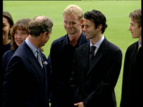 prince charles shakes hands with manchester united players david may ryan giggs and david beckham in grounds of old trafford manchester; 19 sep 97 - photo call stock videos & royalty-free footage