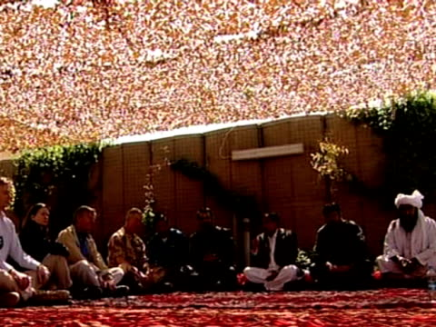 prince charles sits with afghan elders during trip to afghanistan 25 march 2010 - 2001年~ アフガニスタン紛争点の映像素材/bロール