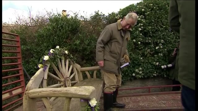 prince charles sitting on decorated garden bench and transported through flood waters by a tractor during his visit to the flood affected somerset... - somerset levels stock videos and b-roll footage