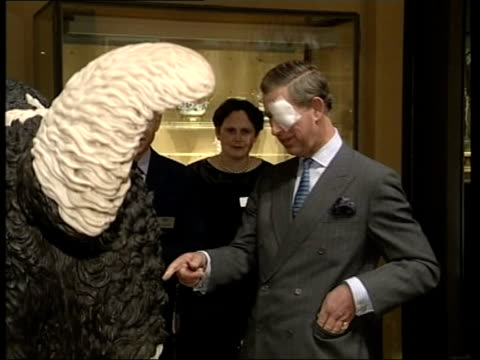 prince charles - sore eye; england: london: victoria & albert museum: int prince charles, prince of wales looking at sheepdog sculpture at museum cms... - museum stock videos & royalty-free footage