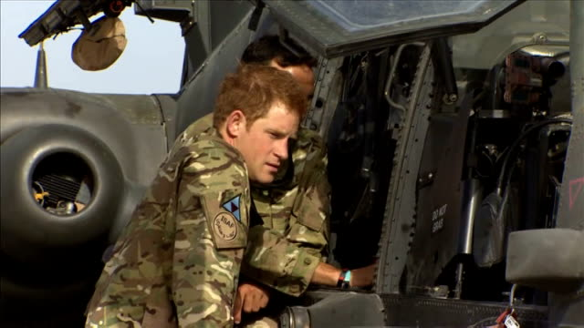 prince charles talks of his fears about prince harry serving in afghanistan cutaways camp bastion ext various of prince harry and army colleague... - アパッチヘリコプター点の映像素材/bロール