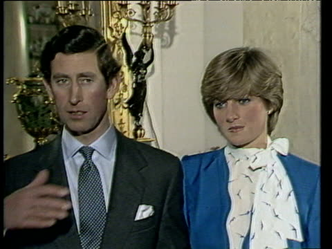 Prince Charles talks with Diana by his side of time and location of their future wedding following announcement of their engagement London 24 Feb 81