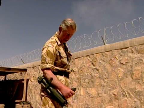 prince charles tests metal detecting equpment during trip to afghanistan 25 march 2010 - 2001年~ アフガニスタン紛争点の映像素材/bロール