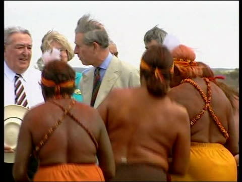 royal prince charles tour of new zealand file / tx alice springs charles greeted at airport by dancing aboriginal women in traditional dress - 2005 stock videos & royalty-free footage