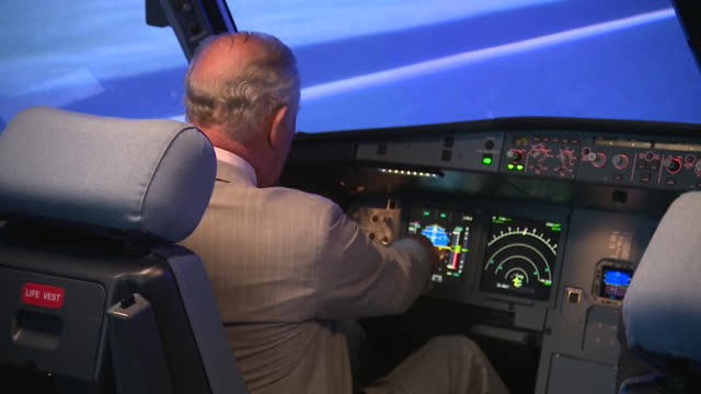 prince charles tries out flight simulator during visit to l3harris technologies london training centre - pilot stock videos & royalty-free footage