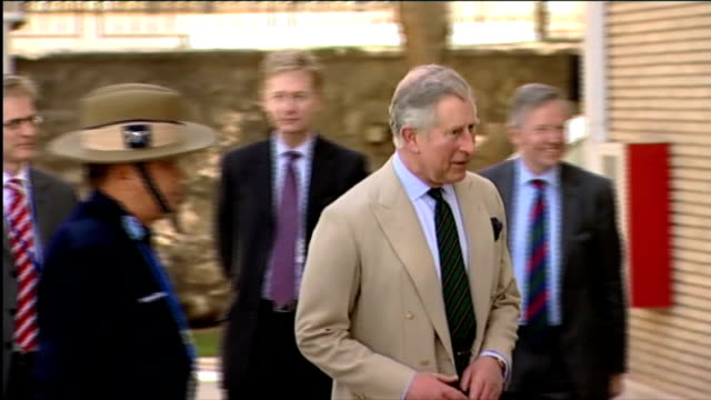 prince charles visit; man introducing prince charles to afghan potter and others ext prince charles along through grounds of turquoise mountain... - jolly video stock e b–roll