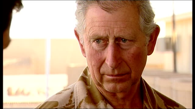 prince charles visit to camp bastion prince charles along to speak to press / side view charles talking to embedded reporters sot prince charles... - provincial reconstruction team stock videos and b-roll footage