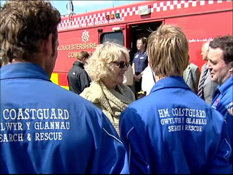 prince charles visit to raindamaged cheltenham racecourse camilla chatting to members of coastguard sot / prince charles chatting to fire service... - cheltenham racecourse stock videos and b-roll footage