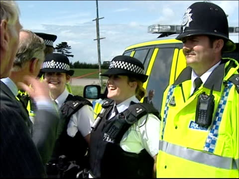 prince charles visit to raindamaged cheltenham racecourse various of prince charles chatting to and shaking hands with police officers sot / prince... - cheltenham racecourse stock videos and b-roll footage