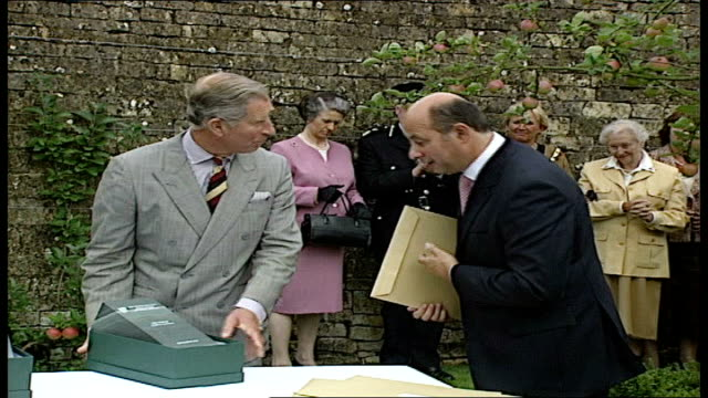 prince charles visit to restored tudor estate in gloucestershire group of people in suits gathered in gardens for presentation of pinnacle award /... - stirling stock videos and b-roll footage