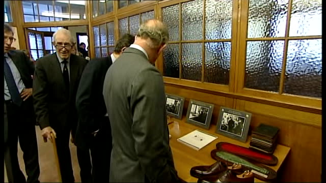 prince charles visit to shoemakers factory in northampton; england: northamptonshire: northampton: int prince charles up old stairs and being shown... - northampton england stock videos & royalty-free footage