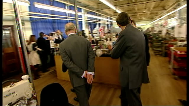 prince charles visit to shoemakers factory in northampton more of prince charles meeting staff on factory floor / women workers taking photographs... - northampton stock-videos und b-roll-filmmaterial