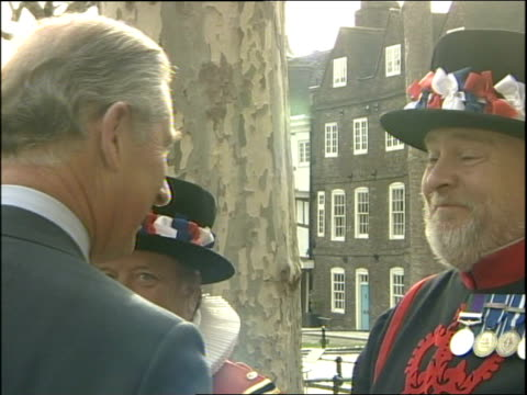 stockvideo's en b-roll-footage met prince charles visit to tower of london and cruise up river thames tower bridge and more of prince charles shaking hands and chatting to beefeaters... - yeomen warder