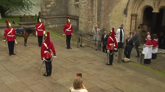 prince charles visit to wales: queen's dragoon guards ceremony; wales: cardiff: llandaff cathedral: int prince charles, prince of wales signing... - signierstunde stock-videos und b-roll-filmmaterial
