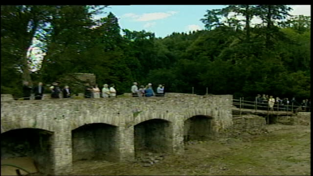 prince charles visits aberglasney gardens pool carmarthenshire llangathen aberglasney gardens ext prince charles along thru wooded area of garden /... - prince stock videos and b-roll footage