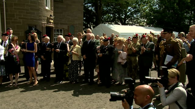 prince charles visits balhousie castle in perthshire ext charles chatting to men / charles along / charles unveiling plaque / charles looking at... - perthshire stock videos & royalty-free footage