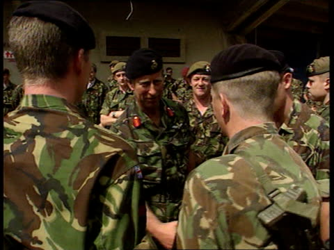 Prince Charles visits British troops in Kosovo ITN Serbia Kosovo Pristina Prince Charles the Prince of Wales along from plane salutes officer as...