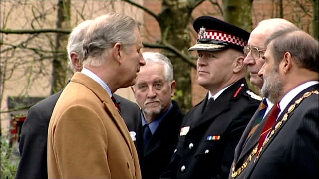 Prince Charles visits Cockermouth following recent flooding ENGLAND Cumbria Cockermouth EXT Officials waiting / Car arriving Prince Charles along...