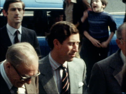 vídeos de stock e filmes b-roll de prince charles visits engineering workers union in south london; england: london: peckham: ext prince charles shakes hands with group of men as... - peckham