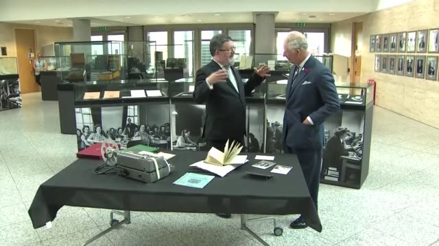 vídeos de stock, filmes e b-roll de prince charles visits gchq headquarters in cheltenham uk cheltenham prince charles prince of wales shown historical artefacts and photographs during... - cheltenham