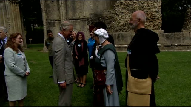 prince charles visits glastonbury charles along garden area / charles along with others / charles chatting to line up / michael eavis along joining... - historical reenactment stock videos and b-roll footage