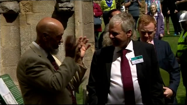 prince charles visits glastonbury; charles along through abbey visitor centre and looking at displays and exhibits / charles along field to abbey /... - glastonbury abbey stock videos & royalty-free footage