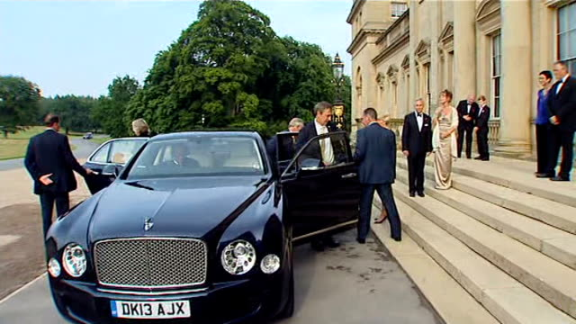 Arrival ENGLAND West Yorkshire Pontefract EXT Motorcade along / Prince Charles Prince of Wales getting out of car as arriving at Harewood House and...