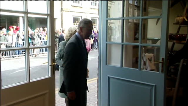 Prince Charles visits 'Highgrove' farm shop in Tetbury Prince Charles Prince of Wales and Camilla Duchess of Cornwall from car waving at locals then...