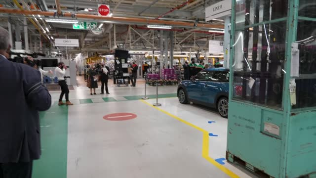 prince charles visits mini factory in oxford; england: oxford: cowley: mini plant: int gv prince charles, prince of wales along with staff past... - zoom in stock videos & royalty-free footage