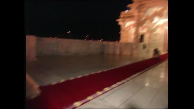 prince charles visits new hindu temple in neasden; england: london: neasden: baps shri swaminarayan mandir: ext / night gvs temple lit up; women... - petal stock videos & royalty-free footage