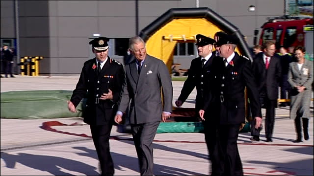 prince charles visits northumberland for the prince's trust's 20th anniversay; ext prince of wales with fire chief talking to officers including one... - プリンスズトラスト点の映像素材/bロール