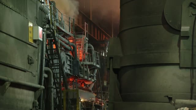 prince charles visits rotherham's historic steelworks england south yorkshire rotherham int bright flame burning in furnace wide shot steelworks with... - south yorkshire stock videos and b-roll footage